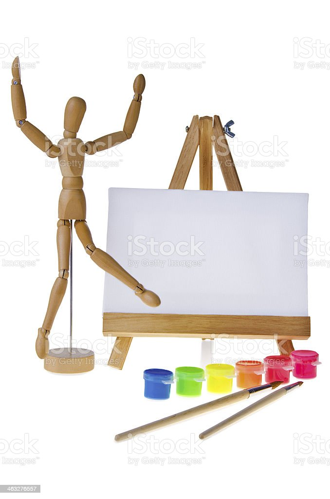 Canvas, brushes and easel stock photo