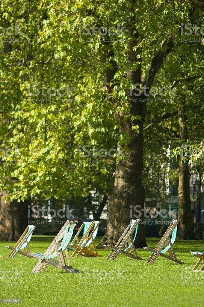Canvas deck chairs in the park royalty-free stock photo