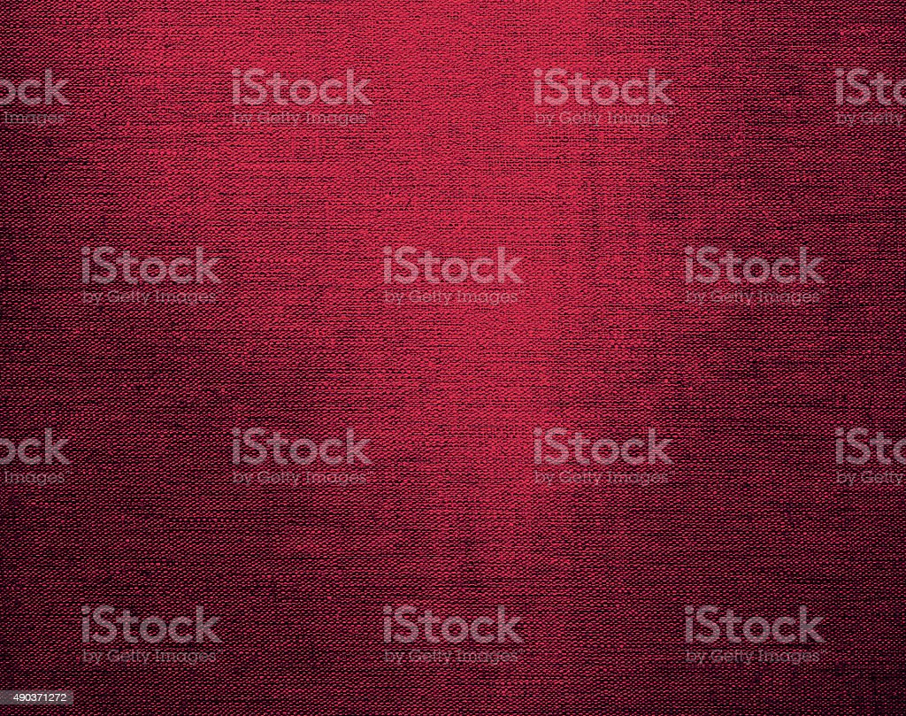 Canvas grunge background texture in deep red color stock photo