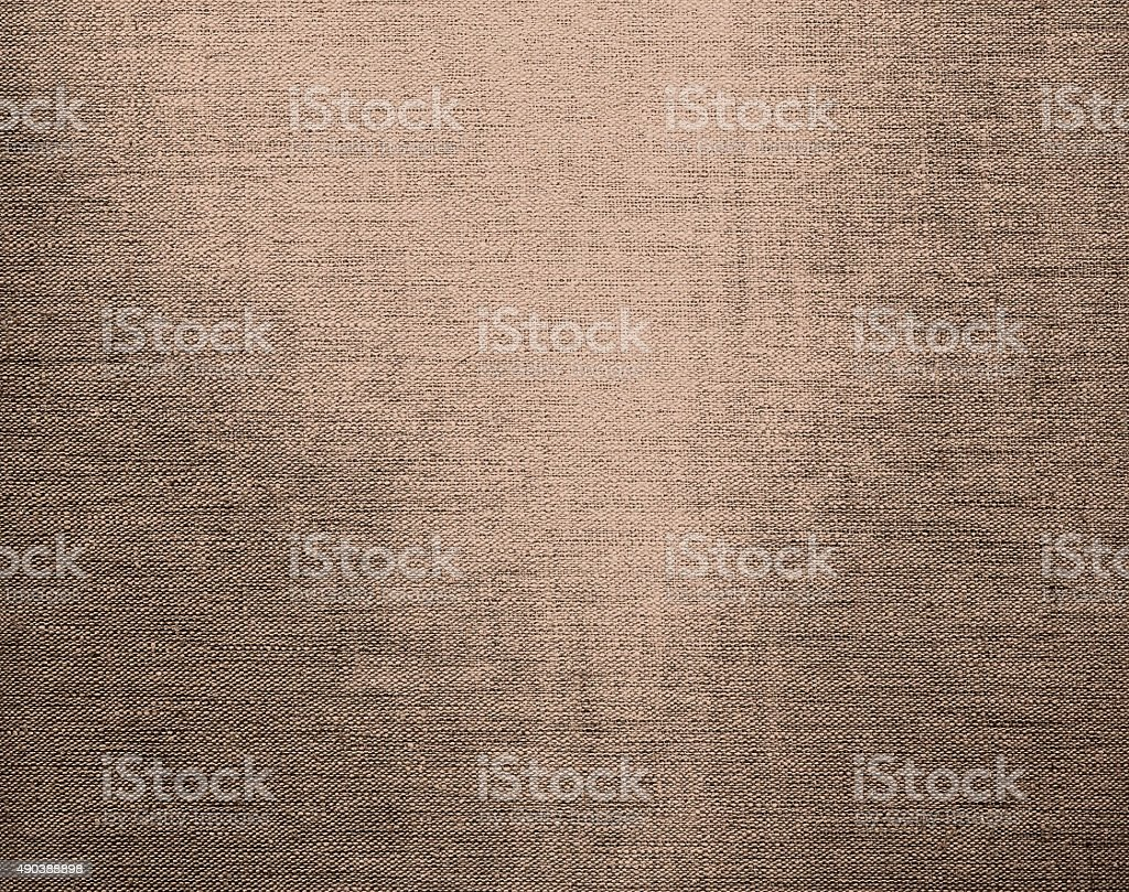 Canvas grunge background texture in pale brown color stock photo