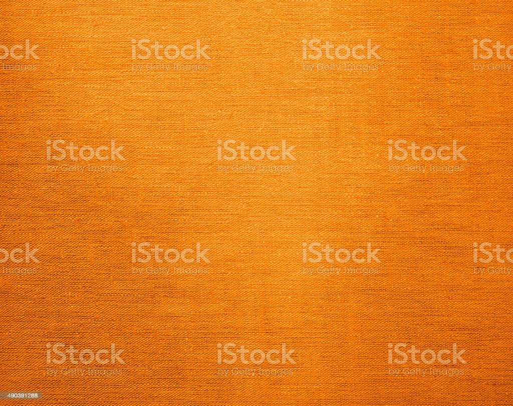 Canvas grunge background texture in yellow color stock photo