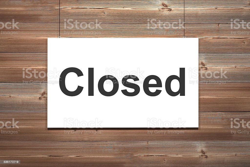 canvas hanging on wooden wall closed stock photo
