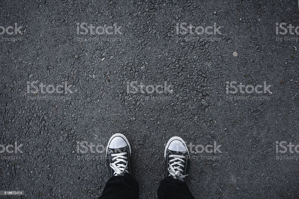 Canvas shoes on asphalt stock photo