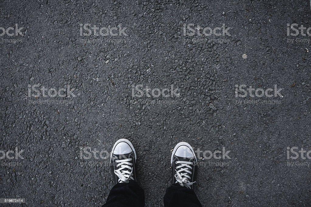 Canvas shoes on asphalt stock photo