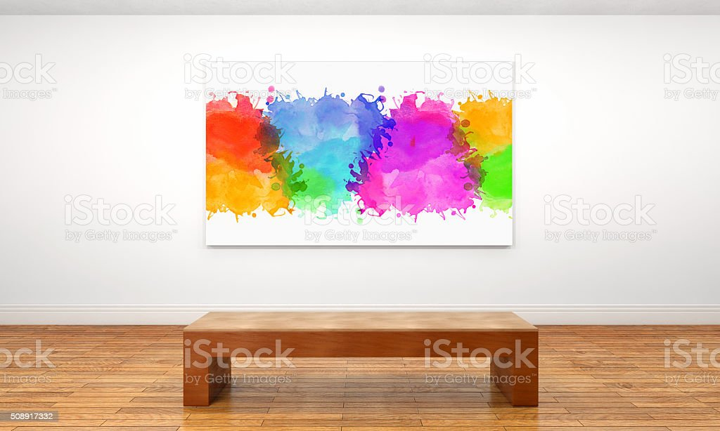 Canvas with a splash of colors on a museum wall stock photo