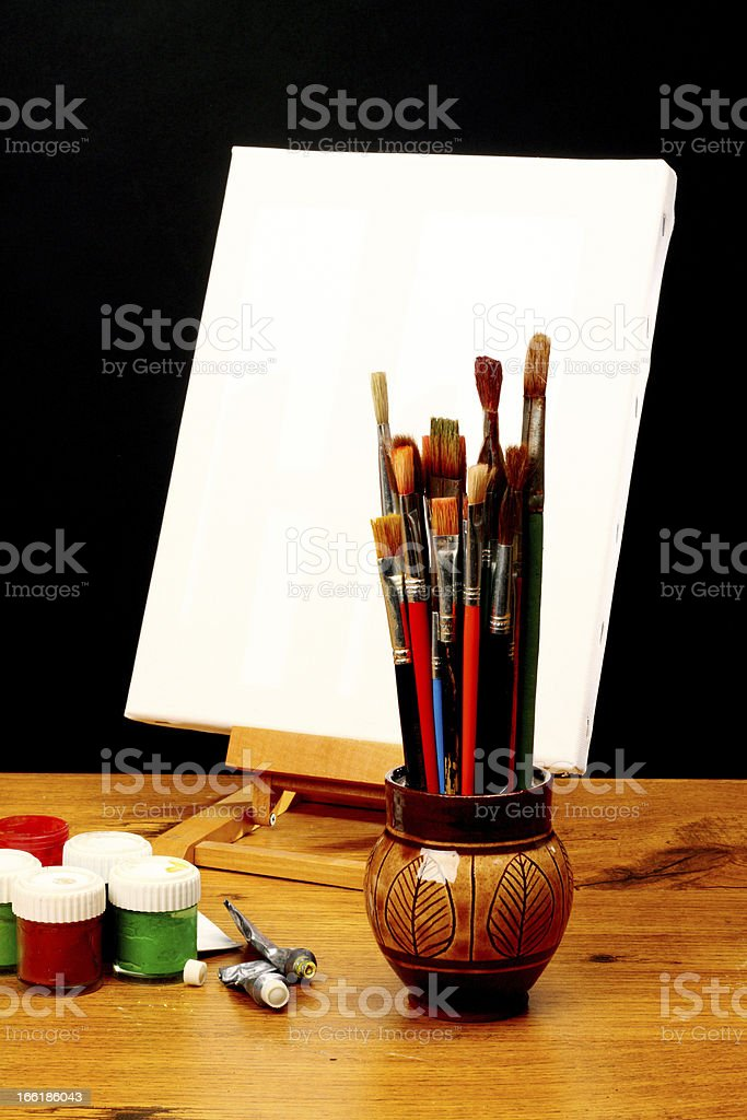 canvas,brushes and easel royalty-free stock photo