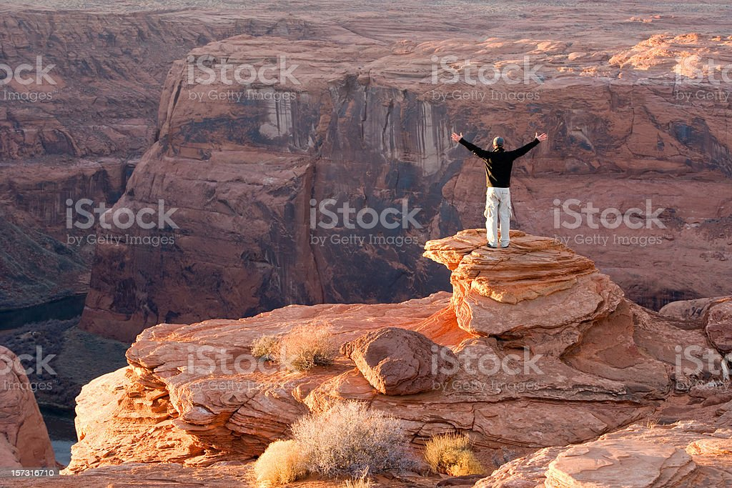 Canyon glory, one male hiker looks over Colorado river, Arizona. stock photo