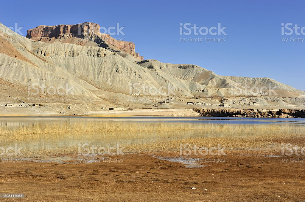 Canyon, lake and village, Afghanistan stock photo