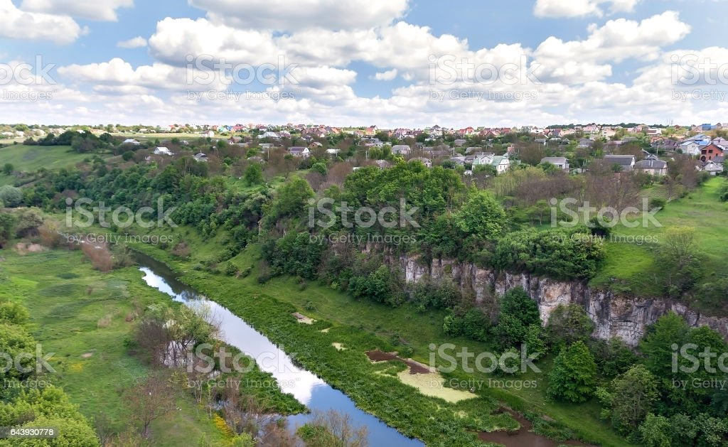 Canyon of the river and houses under cloudy sky in Kamenetz Podolsky stock photo