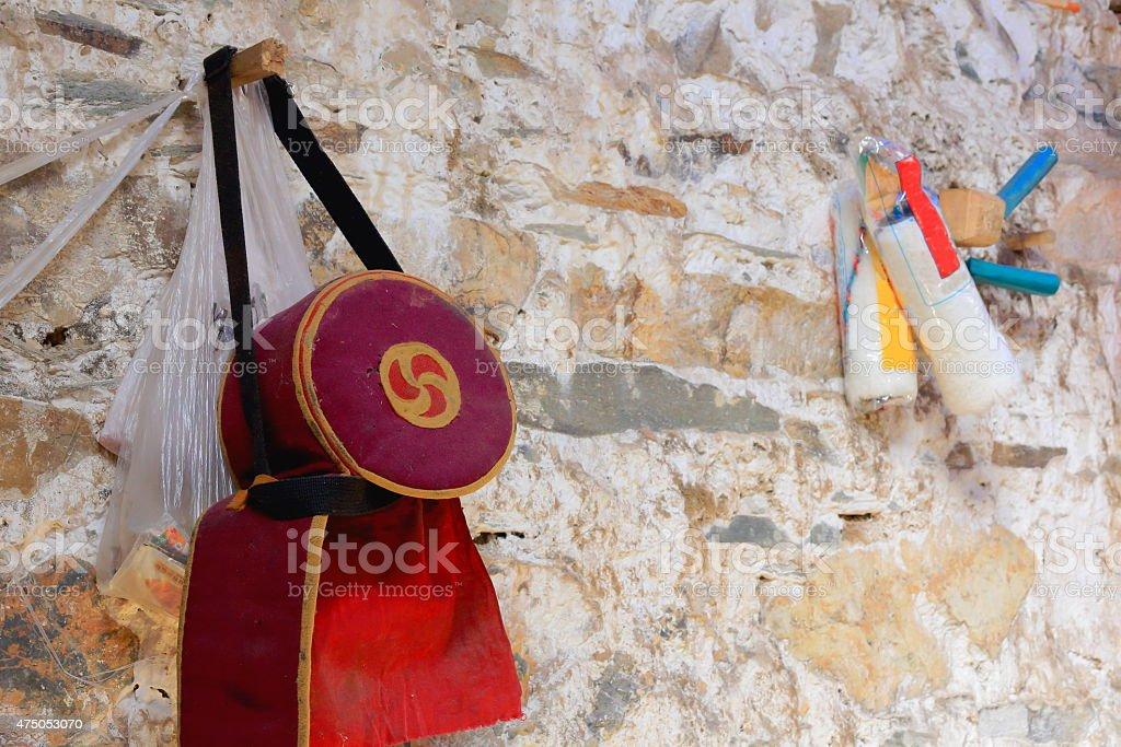 Cap hanging on wall-hut in Drak Yerpa monastery-Tibet. 1484 stock photo