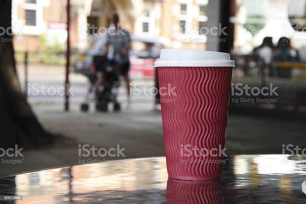cap of take-out coffee on a street  background royalty-free stock photo