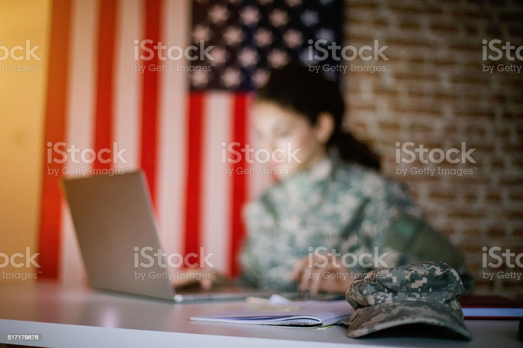 Cap on a table of woman soldier stock photo