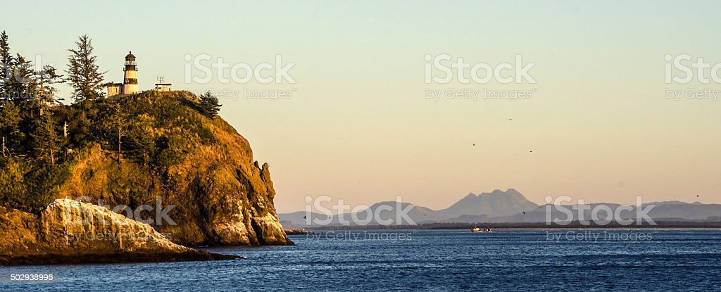 Cape Disappointment Lighthouse at Sunset stock photo