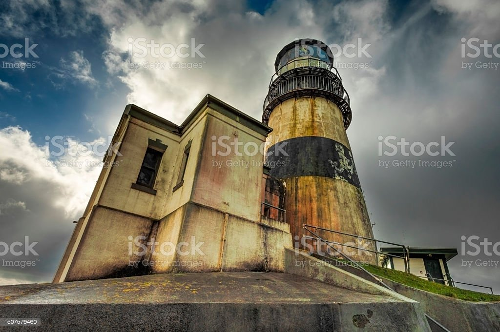 Cape Disappointment Lighthouse under dramatic skies stock photo