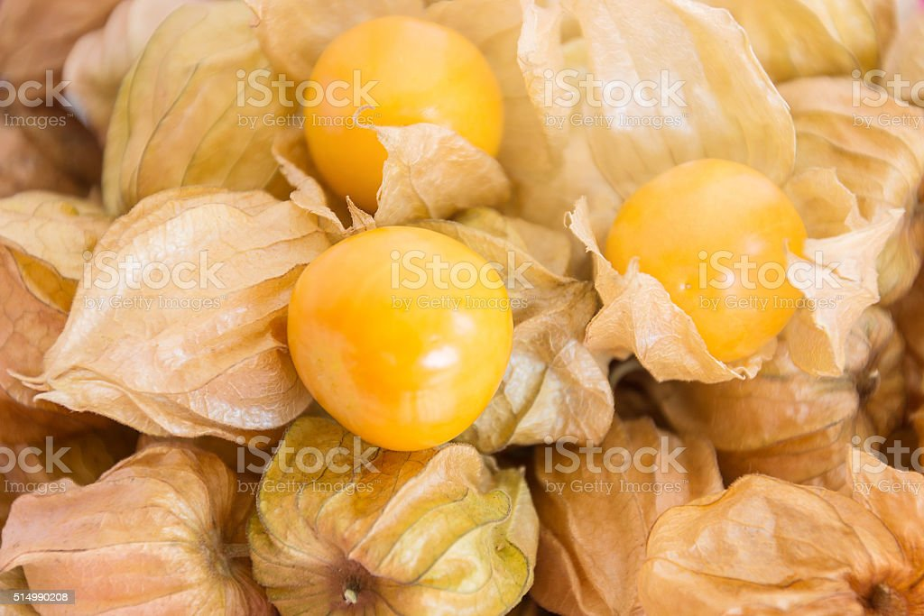 Cape gooseberry (Physalis) on wooden table, healthy fruit and ve stock photo