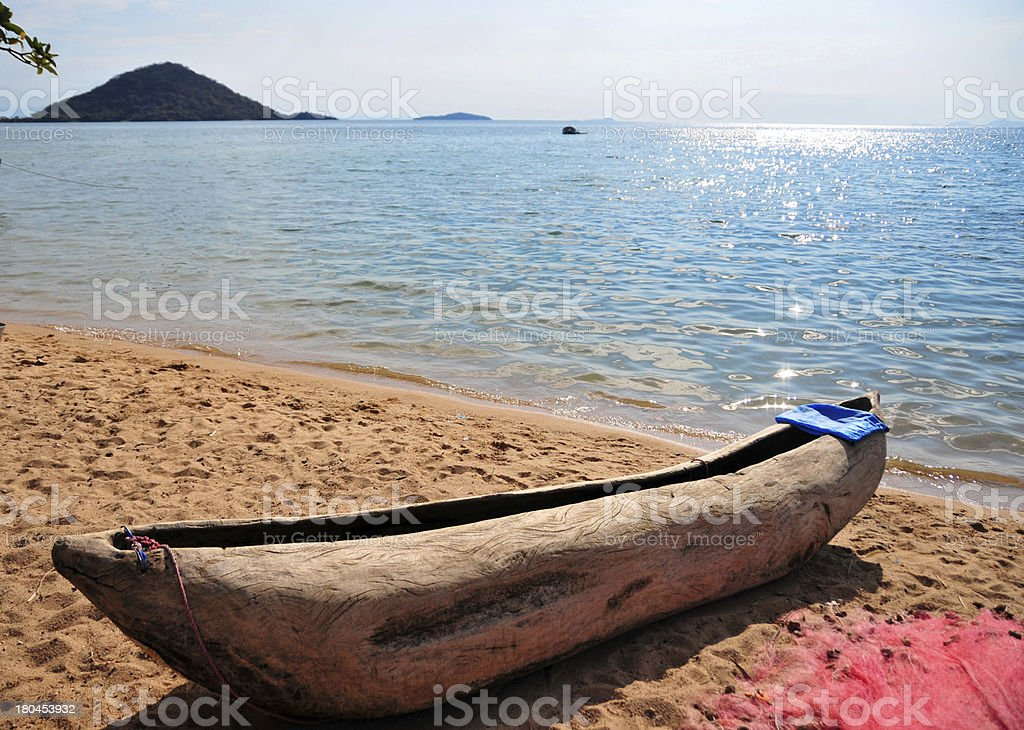 Cape Maclear, Chembe, Malawi: hand carved pirogue on the beach stock photo