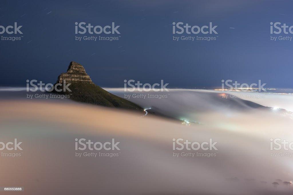 Cape Town lions head nightime fog stock photo