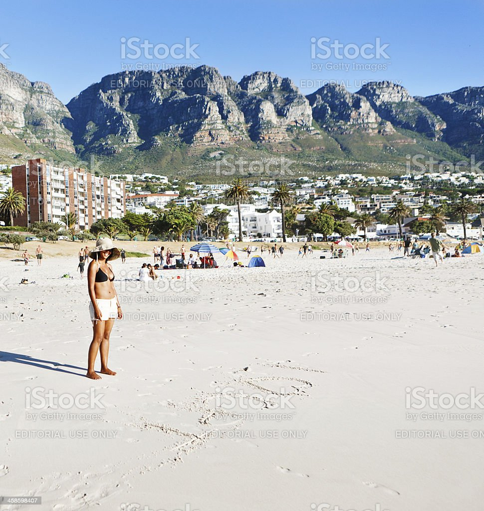 Cape Town's Camps Bay beach with Twelve Apostles in background royalty-free stock photo