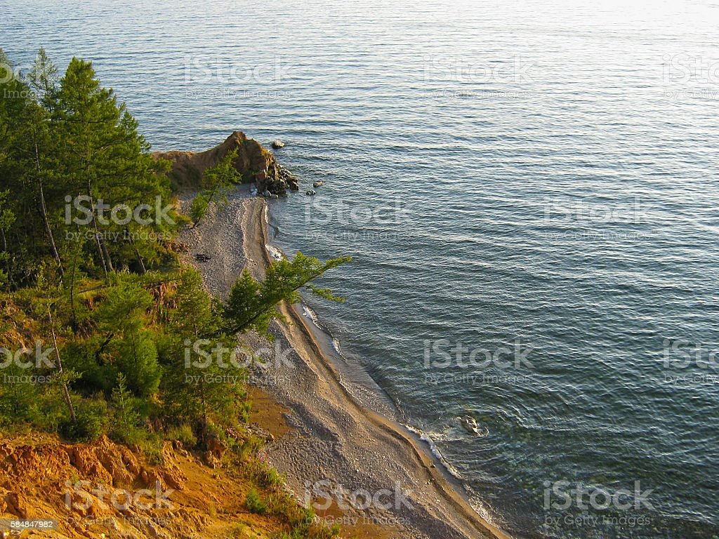 Cape with sandy beach on Lake Baikal. stock photo
