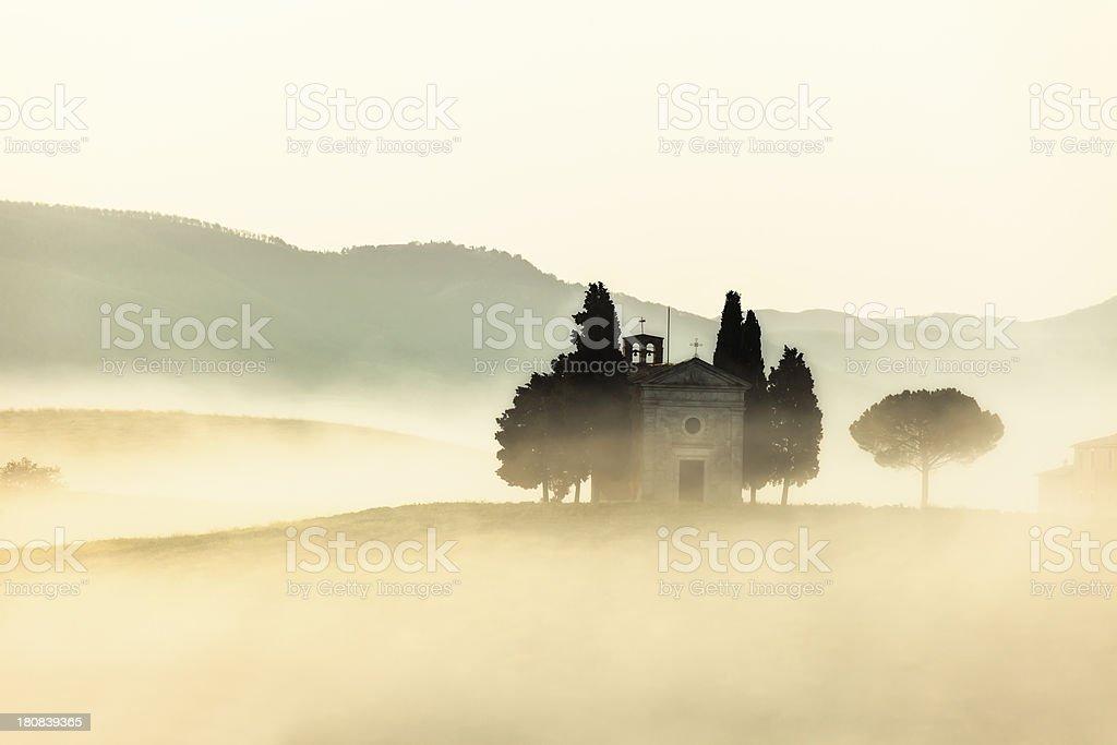 Capella di Vitaleta in Morning Fog, Tuscany, Italy royalty-free stock photo