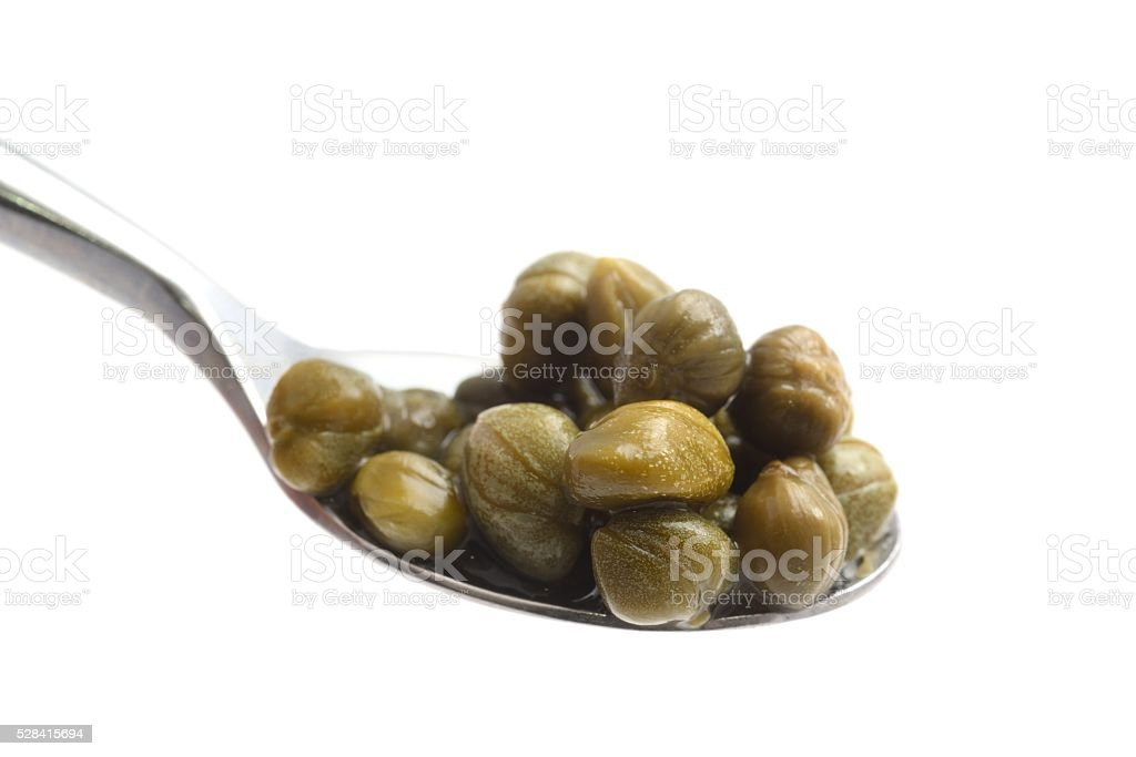 Capers on a spoon stock photo