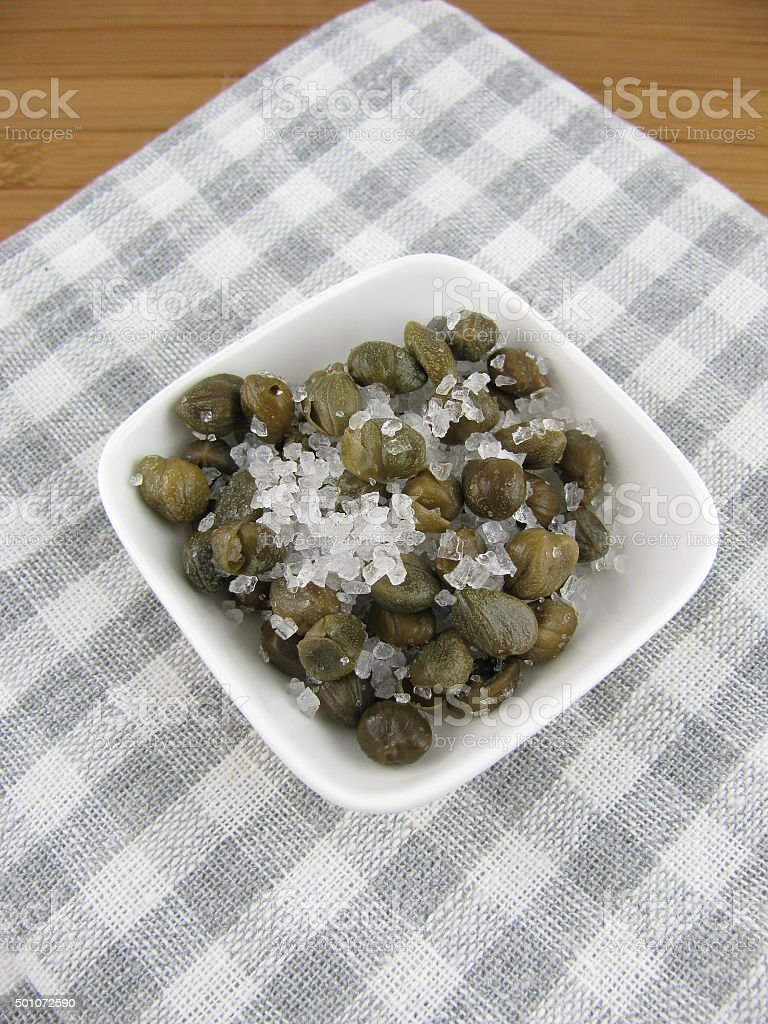 Capers with sea salt stock photo