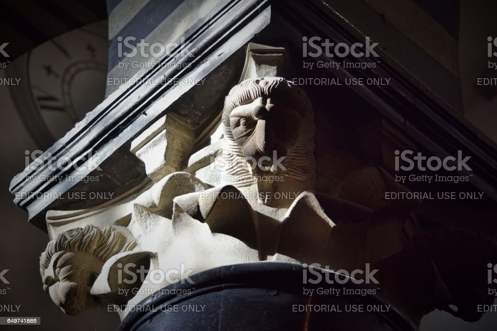 Capital attributed to Guidetto (middle age) above a column in serpentine. Duomo of Prato stock photo