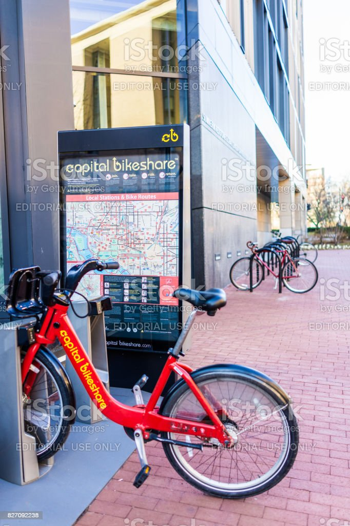 Capital bikeshare sign with red bicycles stock photo
