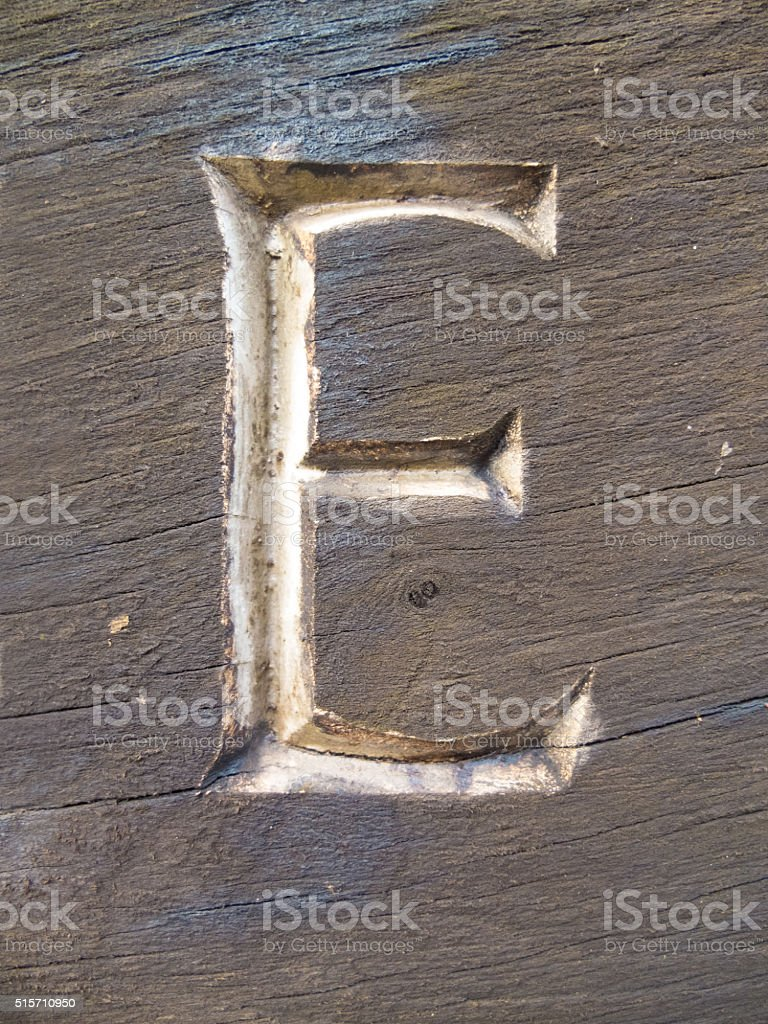 capital e carved in wood stock photo