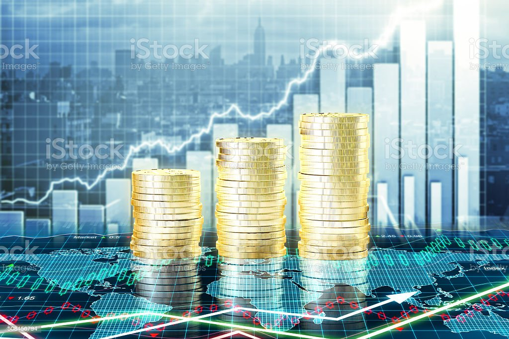 Capital growth concept with growing gold coins and charts stock photo