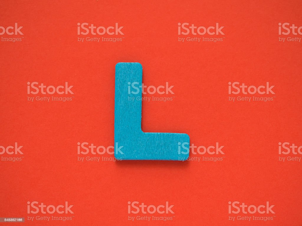 Capital letter L. Blue letter L wood on red background. stock photo