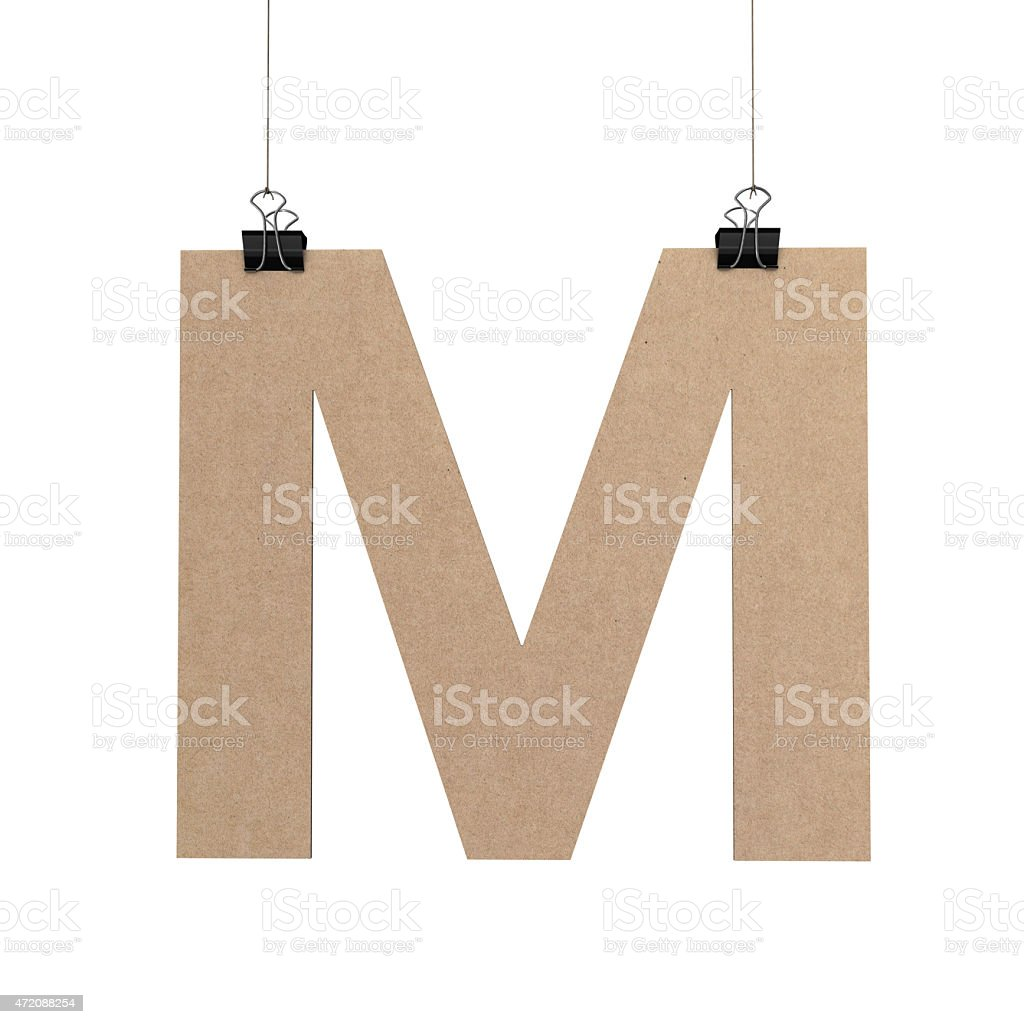 Capital letter M hanging on string stock photo