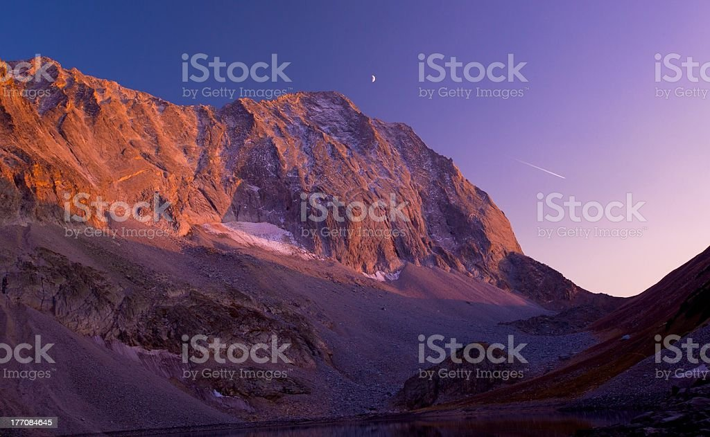 Capital Peak Sunset With Moon and Jet Stream royalty-free stock photo