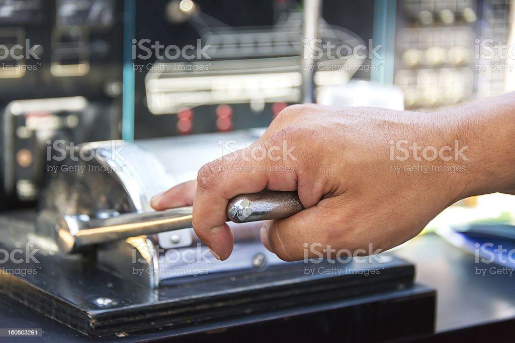 Capitan hand throtling motor boat stock photo
