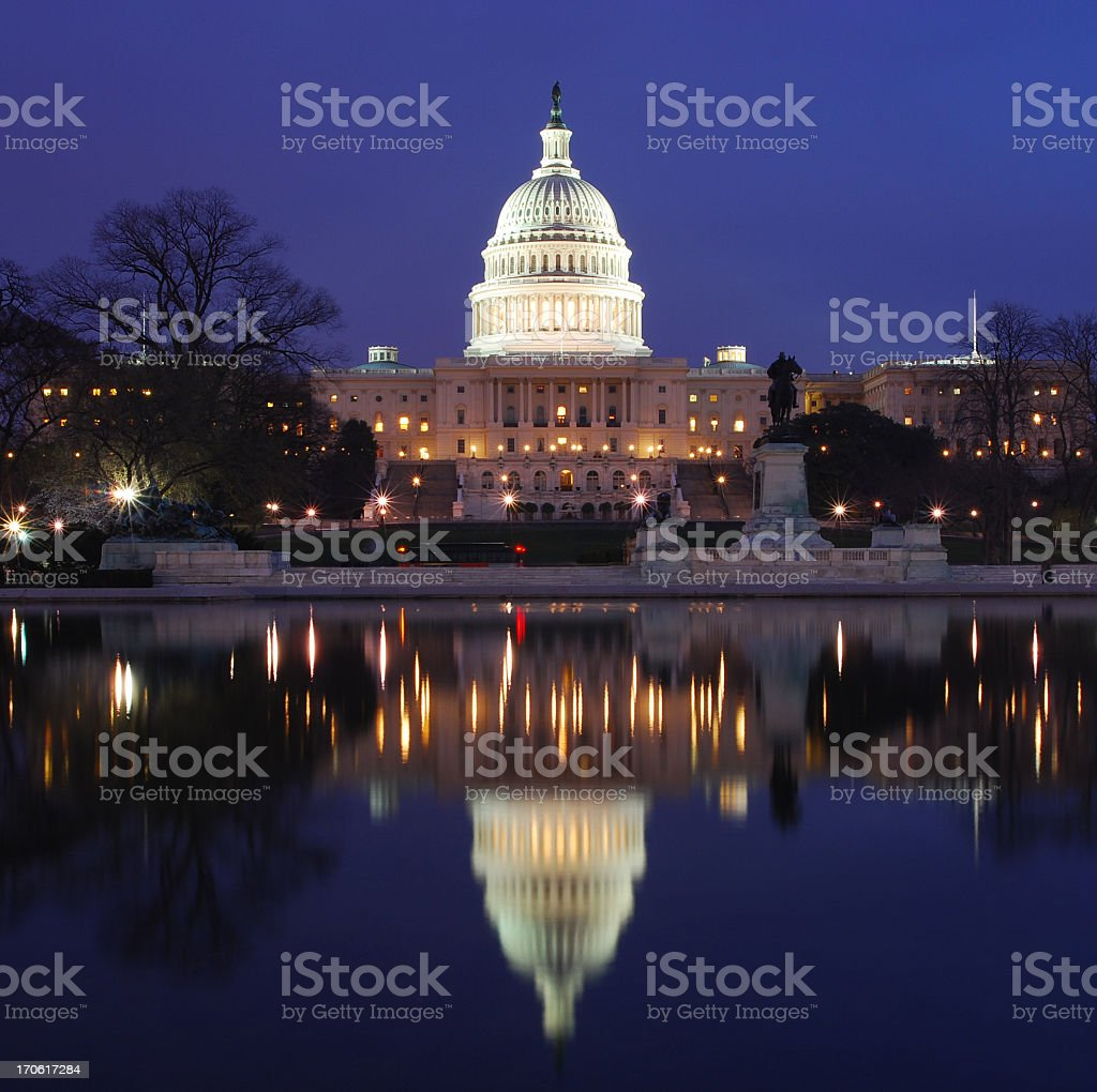 U.S. Capitol and reflection at night stock photo