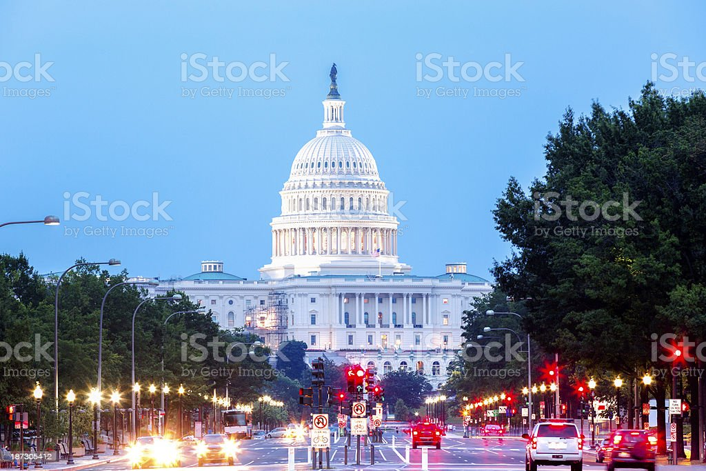 Capitol Building with Car Traffic Foreground stock photo