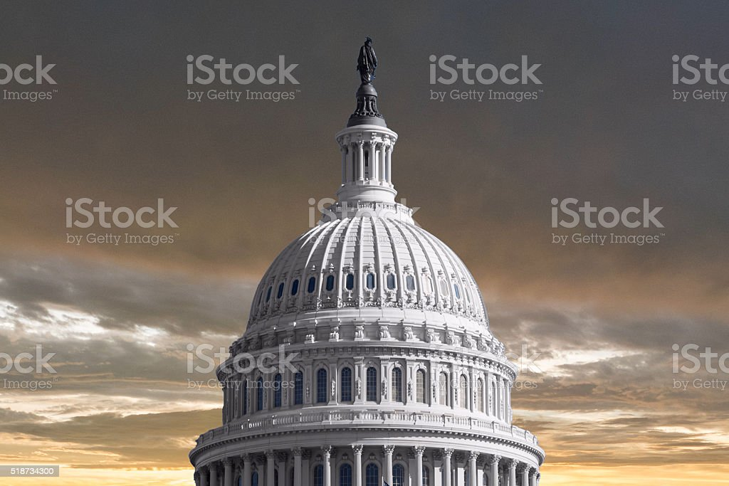 US Capitol Dome with Stormy Sunset Sky stock photo