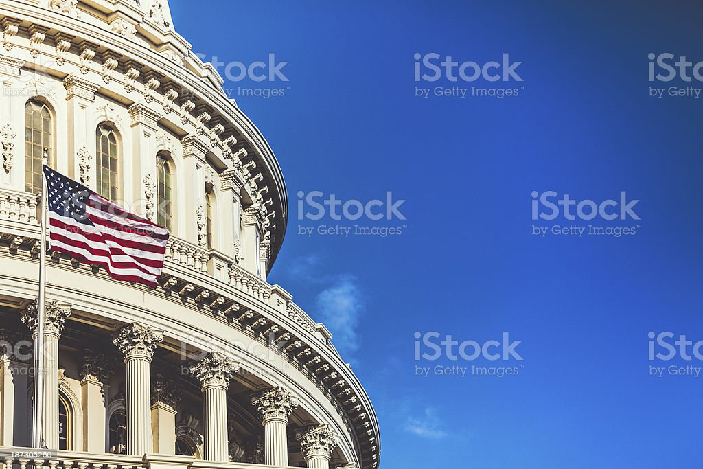Capitol Hill Building in Washington D.C. and U.S. Flag royalty-free stock photo