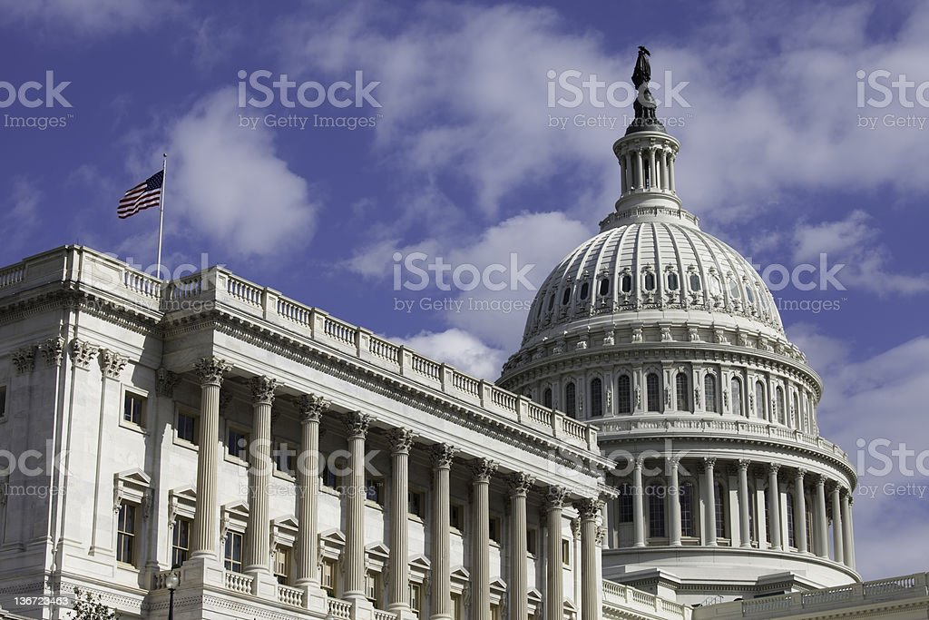 U.S. Capitol with American Flag royalty-free stock photo