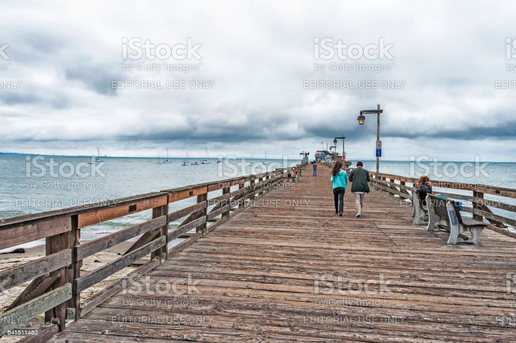Capitola Wharf with Visitors and Boats in Water stock photo