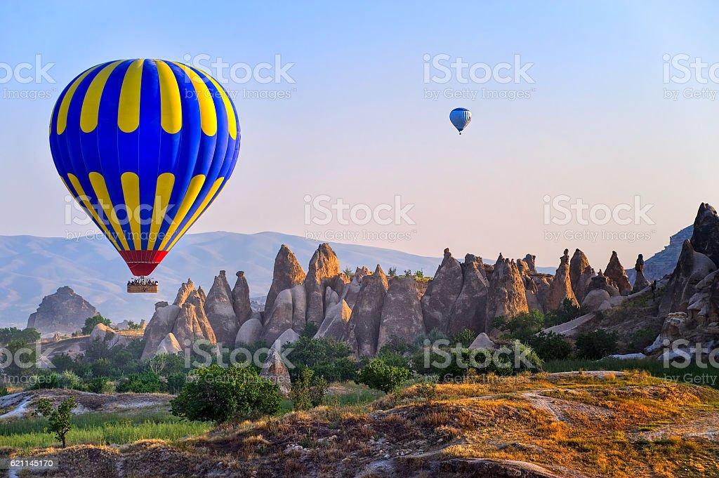 Cappadocia hot air balloon over bizarre rock landscape, Turkey stock photo