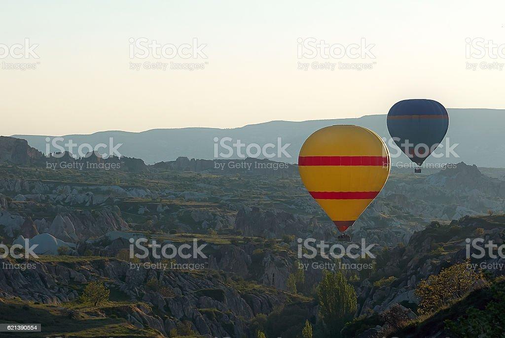 Cappadocia yellow air balloon above hills stock photo