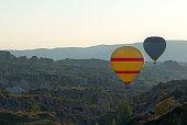 Cappadocia yellow air balloon above hills