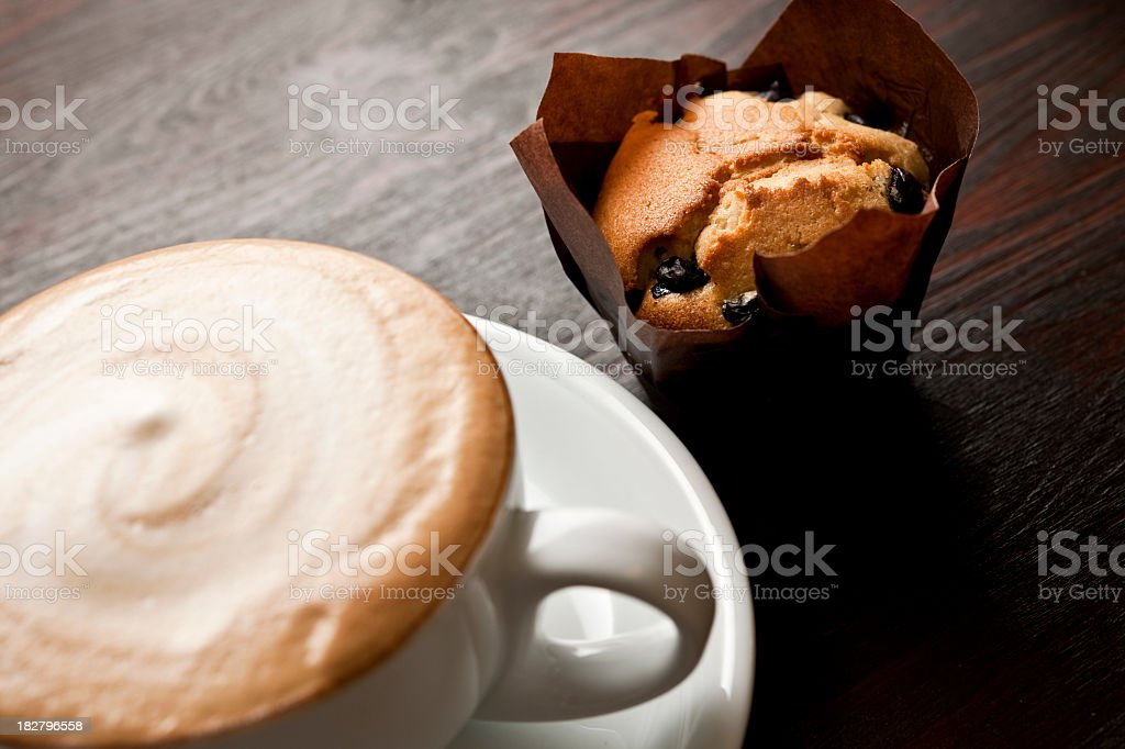 Cappuccino and blueberry muffin royalty-free stock photo