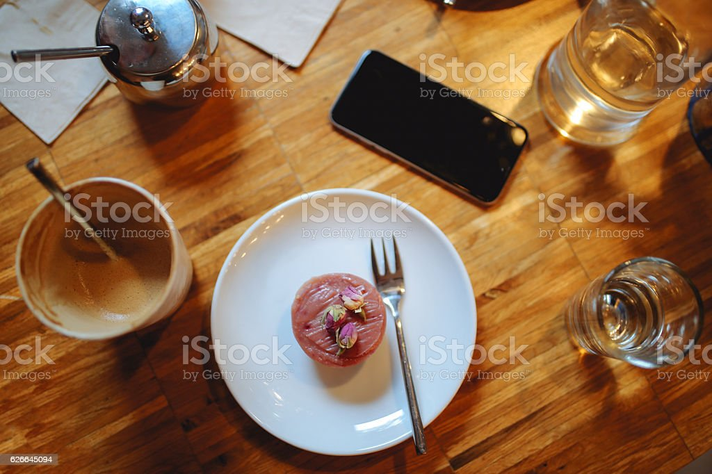 Cappuccino and cake in a cafe in Berlin Kreuzberg stock photo