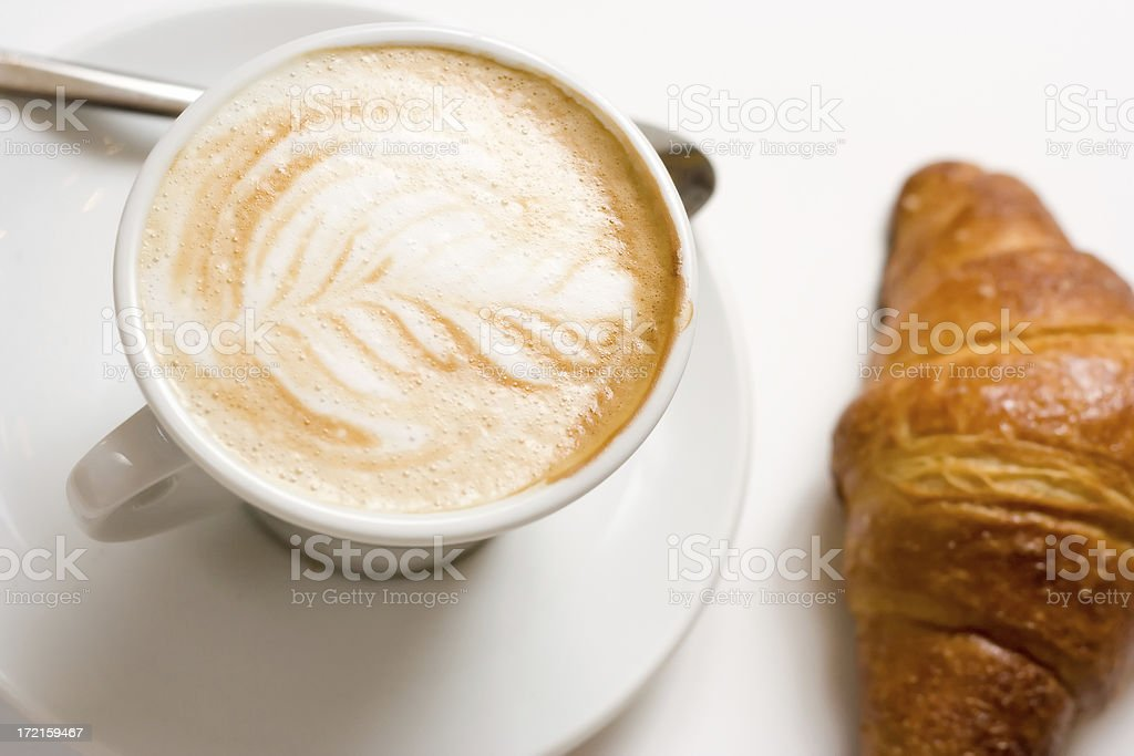 Cappuccino and croissant royalty-free stock photo