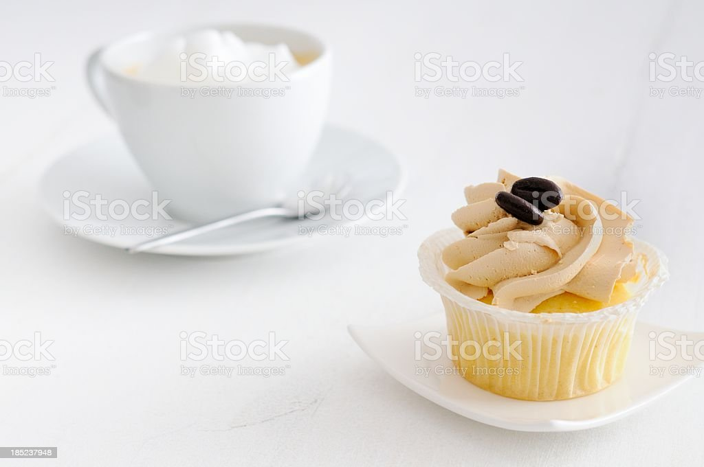 Cappuccino and Cupcake stock photo