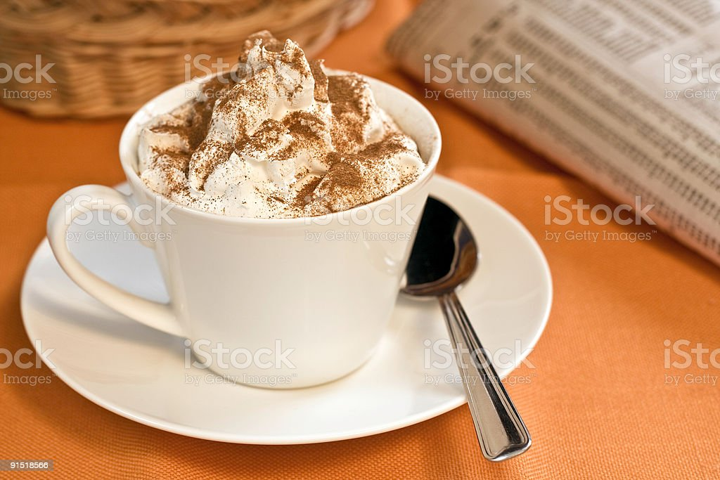Cappuccino and morning paper stock photo