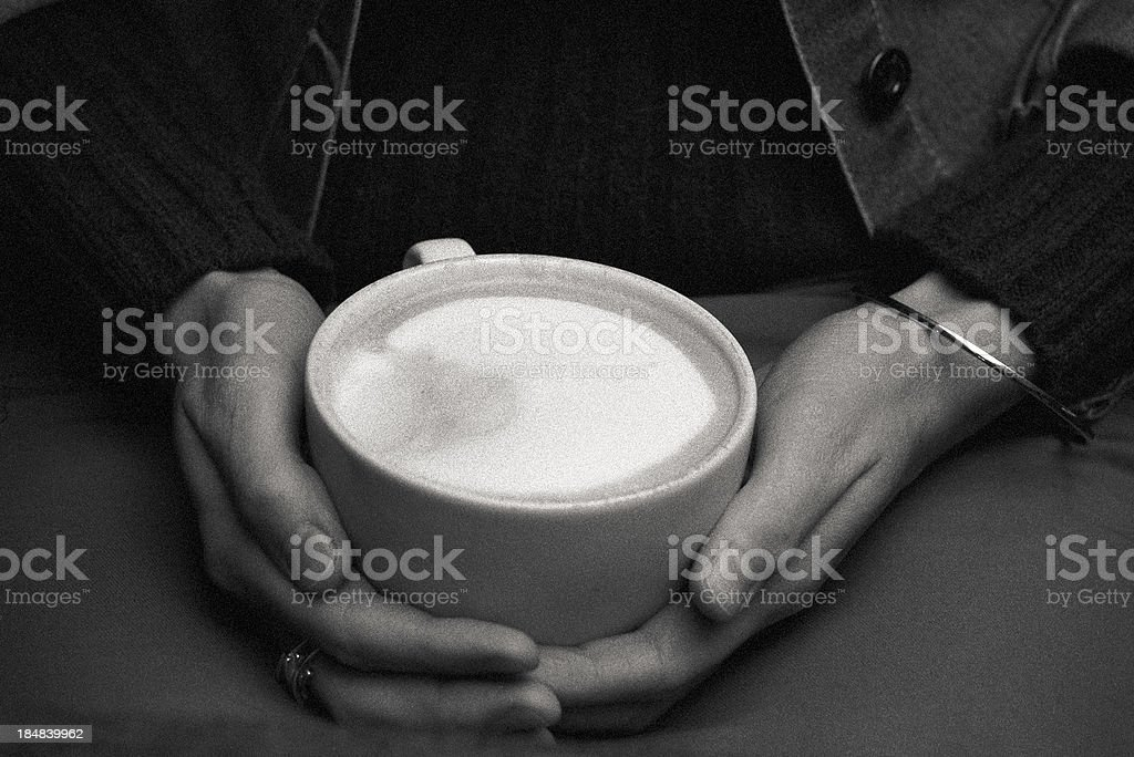 Cappuccino as a hand warmer royalty-free stock photo