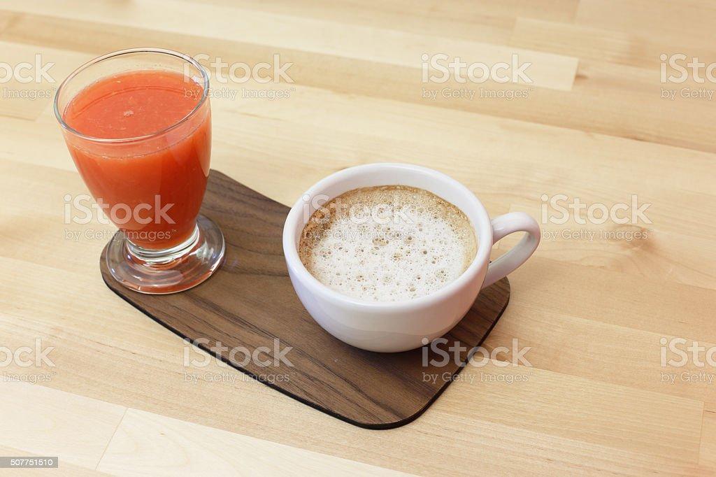Cappuccino coffee and orange juice stock photo